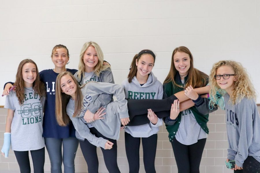 Varsity+Cross+Country+holds+freshman+Colleen+Steggman+after+the+State+Send+Off+in+the+hallways+at+Reedy.+