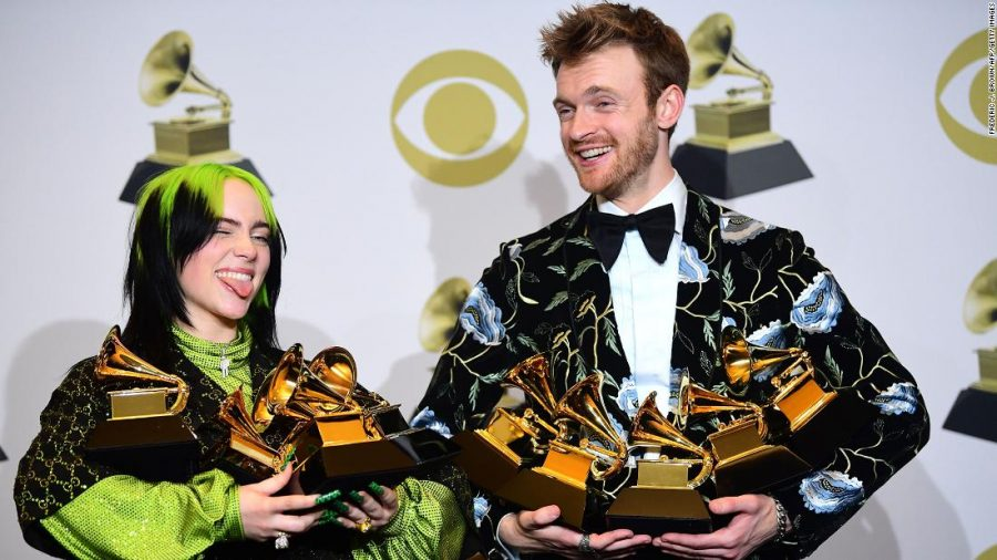 US singer-songwriter Billie Eilish (L) and Finneas O'Connell pose in the press room with the awards for Album Of The Year, Record Of The Year, Best New Artist, Song Of The Year and Best Pop Vocal Album during the 62nd Annual Grammy Awards on January 26, 2020, in Los Angeles. (Photo by FREDERIC J. BROWN / AFP) (Photo by FREDERIC J. BROWN/AFP via Getty Images)