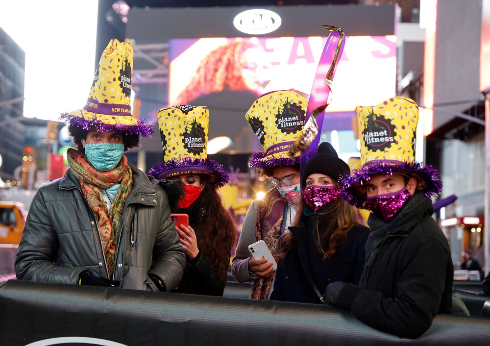 Revelers gather in their social distance pods in Times Square on New Years Eve in New York City, U.S., December 31, 2020. Gary Hershorn/Pool via REUTERS